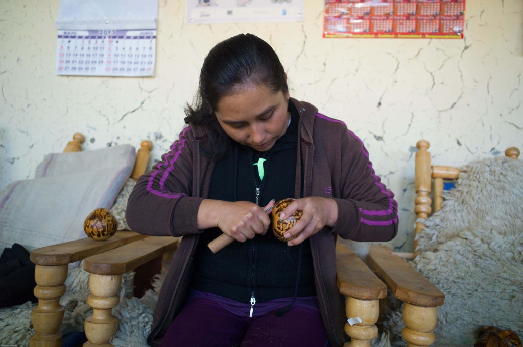 An artisan from Manos Amigas in Lima, Peru, creates an ornament that will be sold through fair trade retailer Ten Thousand Villages. (Photo by Jonathan Bowman)
