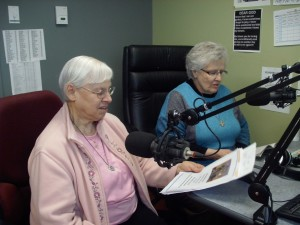 Sisters Pauline Girodat, left, and Joan Liss who work at the Fort Good Hope Mission in the Northwest Territories, host Church Hour at local radio station CBQE. (Photo courtesy of Sisters Girodat and Liss)