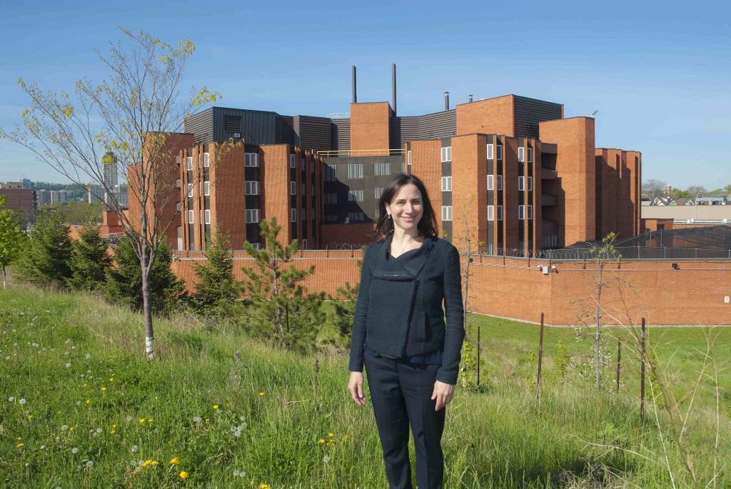 Dr. Fiona Kouyoumdjian, pictured outside of the Hamilton-Wentworth Detention Centre, believes Canadian prisons give doctors the opportunity to work with a population in our own country dealing with human rights concerns. (Photo by John Haney)